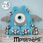 Monstroubles-Batch-05-NEW-MONSTERS-6g-2016-001-BED-Turquoise-Fluffy-Dark-Sugar-Skulls-Odds-and-Soxlets-Copyright-Erica-Martyn-PREVIEW-Square-FULL