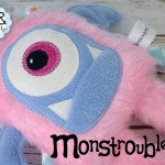 Monstroubles-Batch-05-NEW-MONSTERS-6f-2016-001-CUDDLE-Baby-Pink-Fur-Blue-Roses-Odds-and-Soxlets-Copyright-Erica-Martyn-PREVIEW-Lanscape-Close-Up