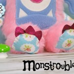 Monstroubles-Batch-05-NEW-MONSTERS-6f-2016-001-CUDDLE-Baby-Pink-Fur-Blue-Roses-Odds-and-Soxlets-Copyright-Erica-Martyn-PREVIEW-Lanscape-TOES